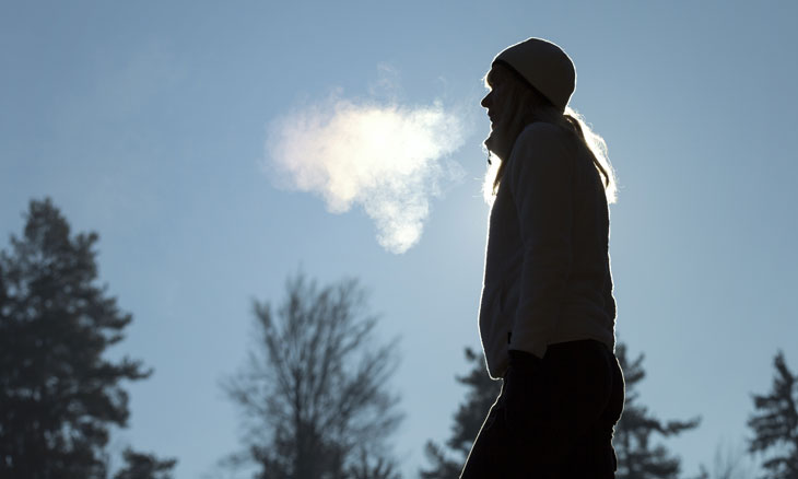 Bayhealth patient outside in winter exhaling warm breath