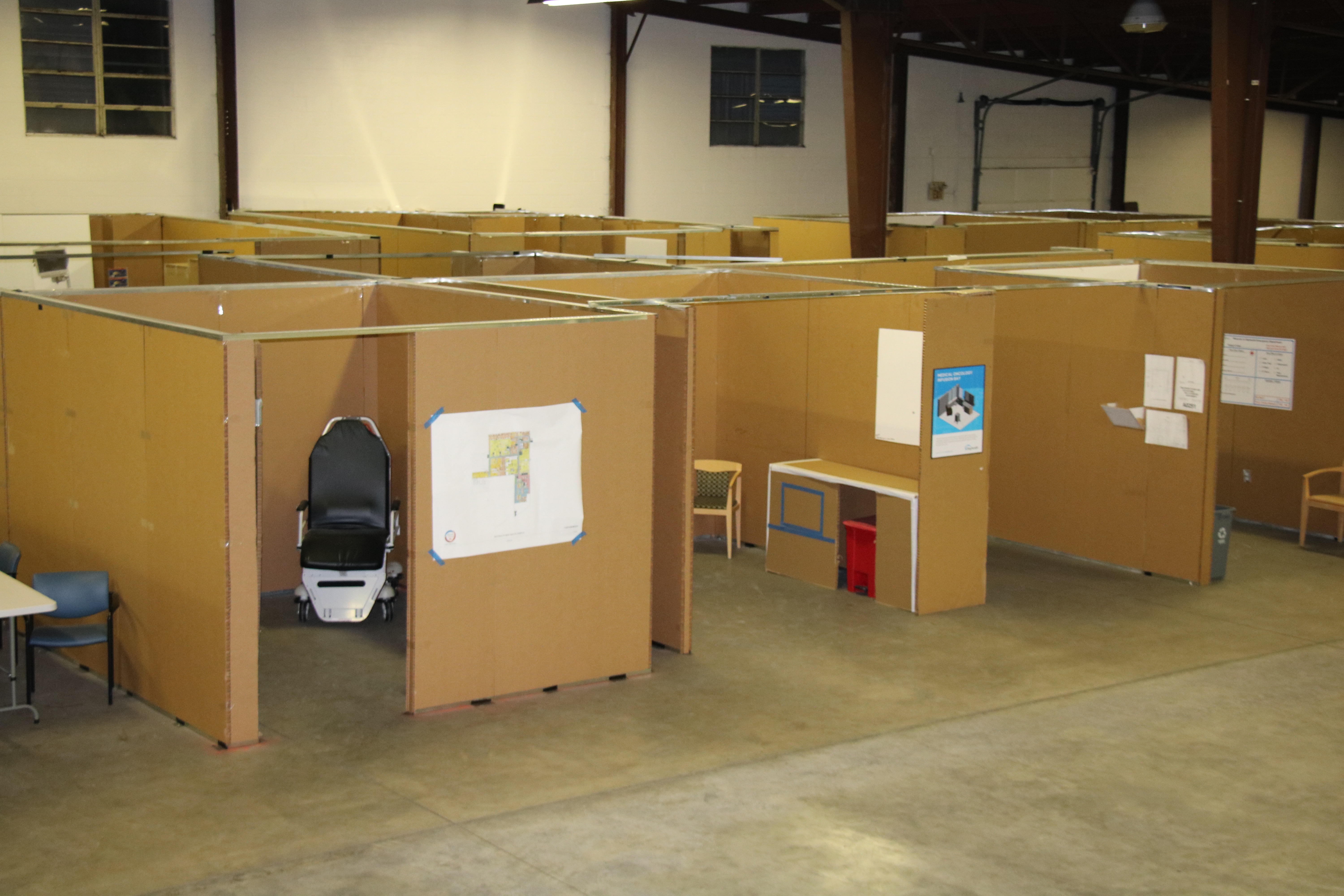 Warehouse with cardboard mock rooms