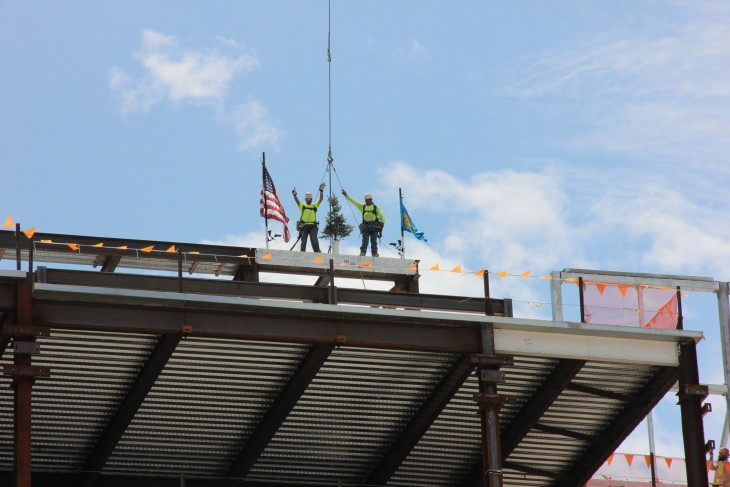 Construction workers on the top of the building frame