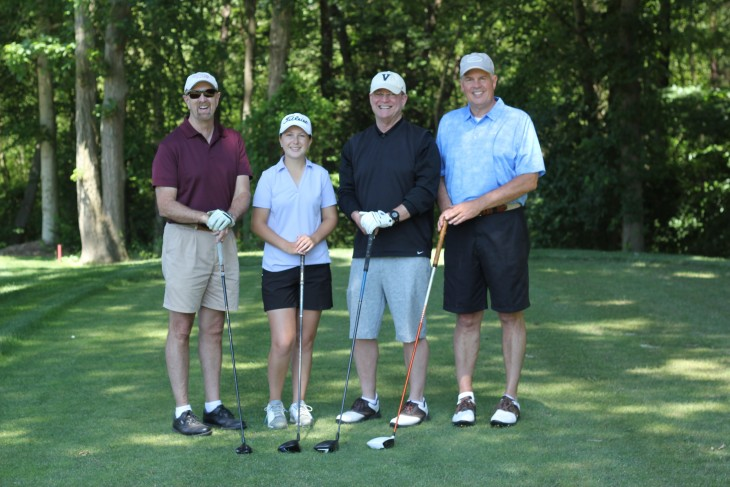 Golfers at spring golf tournament