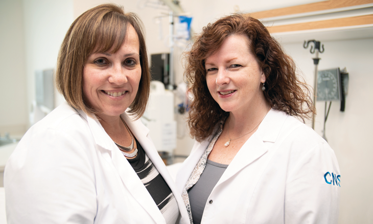 Senior Director of Patient Care Services Andrea Holecek, EdD, MSN, MBA, RN, NE-BC, FACHE (pictured left), and Director of Education Angel Dewey, MSN, RN, APRN, ACNS-BC, CCRN, CNRN (pictured right)