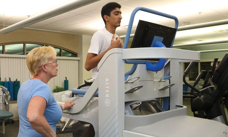 Physician watching patient on Alter G anti gravity treadmill