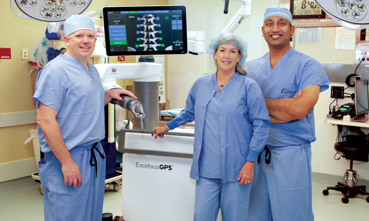 Neurosurgeons with Excelsius surgical robot