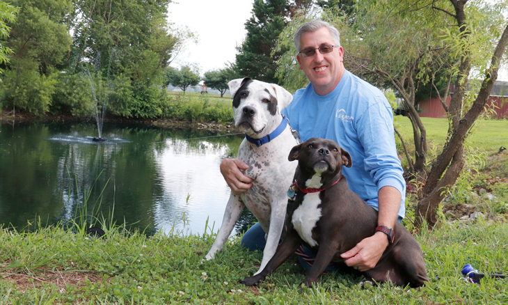 Emergency and trauma services director with his fosters dogs